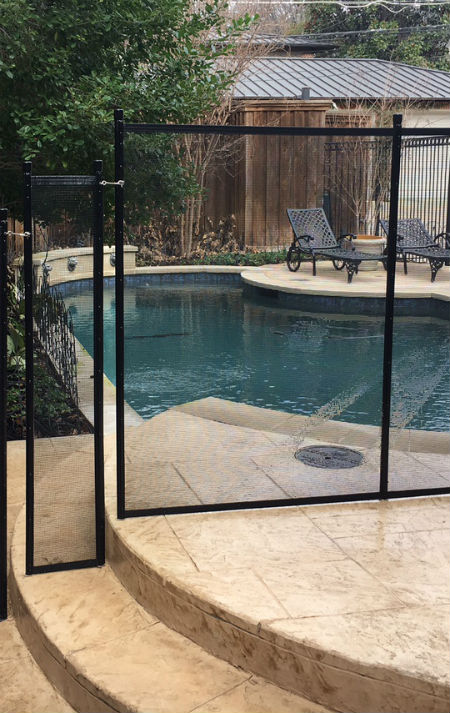 Black pool fence blocking off a patio in the Park Cities