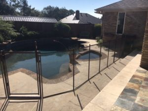 Bronze pool fence with a self closing gate in the Lake Highlands area of Dallas
