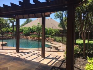 Bronze pool safety gate for this gorgeous pool in Keller, TX