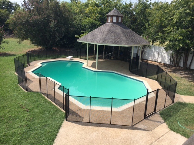 Custom black pool fence with a gate this customer wanted