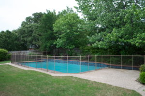 Bronze mesh with tan border and poles coppell